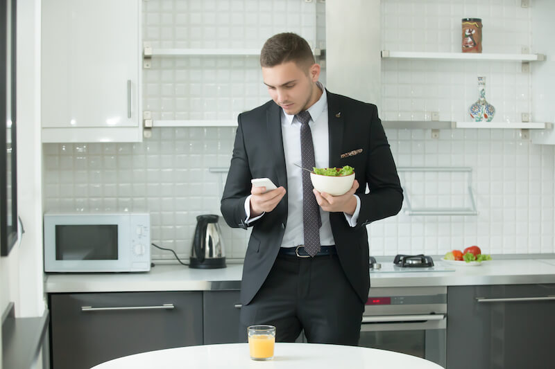 businessman having lunch in the office kitchen