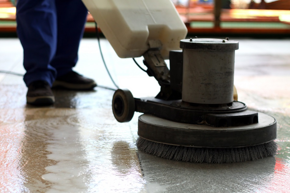 cleaning machine mopping on floor